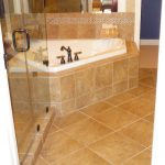 Custom tile flooring and accents in a bathroom complete by Miller Surface Gallery in Savannah, GA