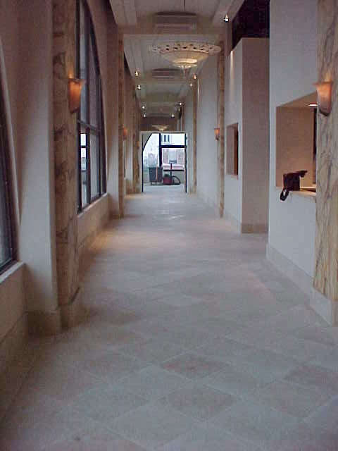 Corridor with new stone and tiling installed by Miller Surface Gallery in Savannah, GA